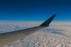 Airplane wing sky clouds Royalty Free Stock Images