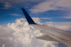 Airplane wing sky clouds Royalty Free Stock Photos