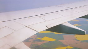 Airplane wing on the sky over land stock video