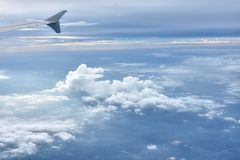 Airplane wing in sky Stock Images