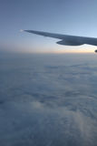 Airplane wing and sunrise Stock Photos