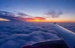 Airplane wing. Sunrise sky landscape royalty free stock image