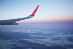 Airplane wing at sunrise sky. Travel Stock Photos