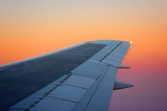 Airplane wing on sunset Royalty Free Stock Photos