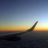 Airplane wing in sunset Stock Images