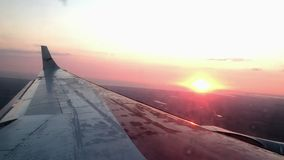 Airplane wing at sunset stock video