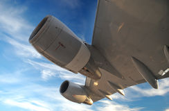 Airplane Wing with turbines. Against blue sky Stock Photography