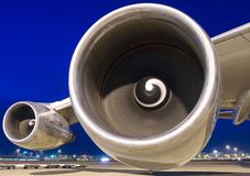 Airplane wing with two turbines royalty free stock images