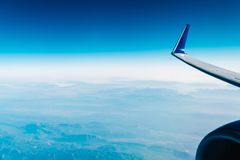 Airplane Wing View Above Clouds Stock Image