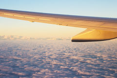 Airplane wing with view of the clouds. Real airplane wing with view of the clouds Royalty Free Stock Photos
