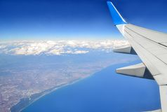 Airplane wing and view down to the ground. royalty free stock images
