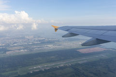 Airplane Wing. View of airplane wing on top of airport runway Stock Images