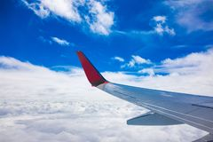 Airplane wing view from the window with blue sky. royalty free stock photos