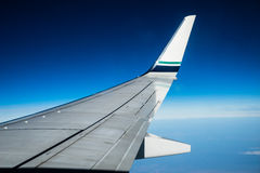Airplane wing and winglet at cruising altitude Stock Image