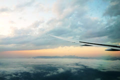 Airplane wing. Wings of an airplane in between clouds Stock Photo