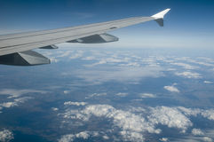 Airplane wings. And higher clouds landscape Royalty Free Stock Images
