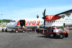Airplane Wings Air on airport. Propeller airplane of indonesian airlines Wings Air, part of Lion Air, on airport in Labuan Bajo, Flores, Nusa Tengara Timur - NTT Royalty Free Stock Images