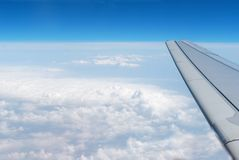 Airplane wings in the blue clouds Royalty Free Stock Photography