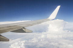 Airplane wings in the blue clouds. Sky Stock Photography
