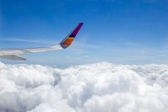 Airplane wings in the blue sky. And sea of cloud Stock Image
