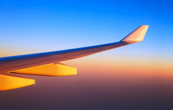 Airplane wings in sunset light Royalty Free Stock Photo