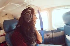 Airplane woman passenger Stock Image