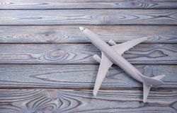 Airplane on wooden boards. Travel, air business. Airplane on wooden boards, postcard place for text. Travel, air business royalty free stock images