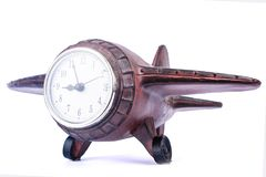 Airplane wooden clock, travel ideas isolate royalty free stock photo