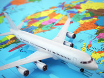 Airplane on world map. Three-dimensional image. Royalty Free Stock Image