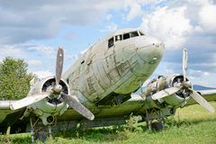 Airplane wreck in a field Stock Photo