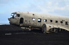Airplane wreck. In Iceland on sandy beach Stock Photo