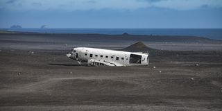 Airplane wreck from left side. In Iceland at summer royalty free stock photo