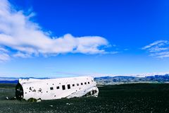 Airplane wreckage in Iceland. The abandoned airplane on Solheimasandur beach, airplane wreckage on black sand beach in Iceland Royalty Free Stock Image