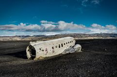 Airplane wreckage Solheimasandur Iceland on black sand beach. Airplane wreckage, Iceland The remains of a Douglas R4D Dakota DC-3 C 117 from the US navy.. This Stock Images