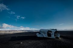 Airplane wreckage Solheimasandur Iceland on black sand beach. Airplane wreckage, Iceland The remains of a Douglas R4D Dakota DC-3 C 117 from the US navy.. This Royalty Free Stock Image