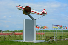 Airplane Yak-52 on a pedestal Stock Photo