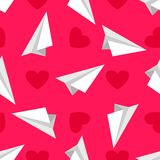 AirplanePattern3. Airplanes made of white paper  and red hearts on the pink background Royalty Free Stock Photos