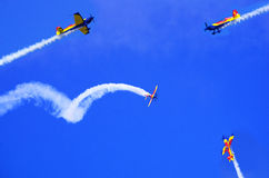 Airplanes. In teamwork formation at airshow acrobatics royalty free stock images