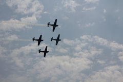 4 Airplanes in air stunt show Royalty Free Stock Image
