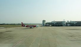 Airplanes of AirAsia on a taxi way to a terminal. royalty free stock photo