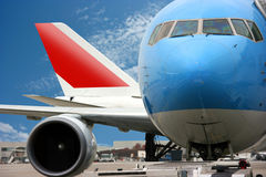 Airplanes at the airport. Blue and red Airplanes at the airport Stock Image