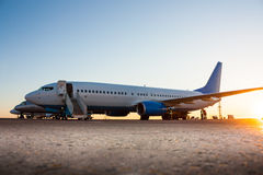 Airplanes in the airport apron. Airplanes in the morning airport apron stock image
