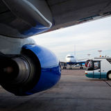 Airplanes and Airport Bus. An airplanes, jet engine and airport bus on an airfield Royalty Free Stock Images