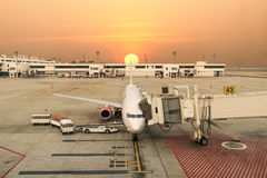 Airplanes in the airport at sunset. View from above Royalty Free Stock Photography