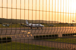 Airplanes in the airport at sunset Stock Image