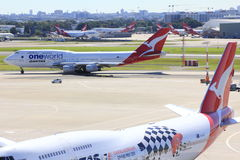 Qantas aircraft in airport scenery Stock Photo