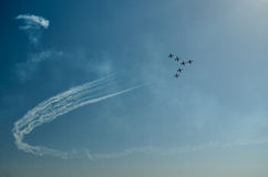 Airplanes on airshow. Aerobatic team performs flight at air show Royalty Free Stock Photography