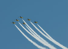 Airplanes on airshow. Aerobatic team performs flight at air show Stock Images