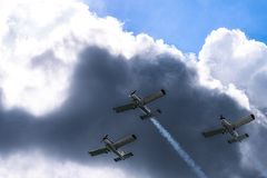 Airplanes on airshow. Aerobatic team performs flight at air show in Krakow, Poland. royalty free stock photography