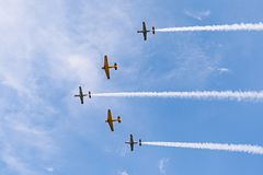 Airplanes on airshow. Aerobatic team performs flight at air show in Krakow, Poland. Airplanes on airshow. Aerobatic team performs flight at air show in Krakow stock photo
